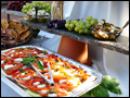 Trays of caprise salad, olives and grapes at a catered backyard wedding