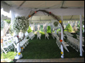 tent decorated with real flowers and tulle for an off site wedding on long island