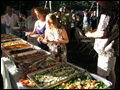 best off premise caterer on Long Island has set up a buffet line for a backyard wedding
