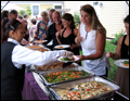 best party caterer on Long Island serving up hot dishes at a tent wedding