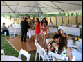 dance floor and dinner tables under white tent