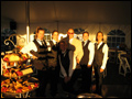 Felico's crew getting ready to cater a backyard wedding