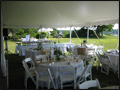 backyard wedding catering tables dressed in white with burlap runners