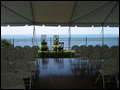 long island back yard wedding in a tent with dance floor and table for the bride and groom