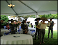 mariachi band entertaining at a catered backyard wedding