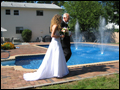 backyard wedding walking down the isle